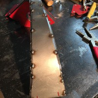 Tack welded sheet metal skin over frame